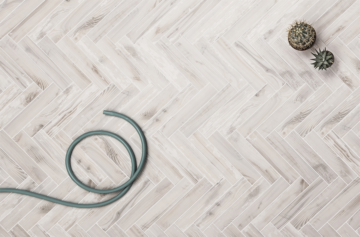 wood look tile set in a herringbone pattern